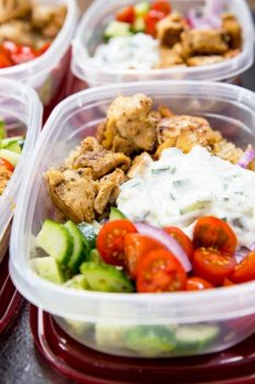Greek Chicken Recipe: Insanely delicious Greek Chicken bowl recipes. Greek Marinated Chicken, cucumber salad, tzatziki, red onion, and tomato, served over brown rice. These are quick and easy to make, and will help you be set for the week.